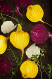Preparing raw beetroots and garlic for roasting on a baking tray. Preparing raw beetroots and garlic for roasting on old baking tray Royalty Free Stock Photography