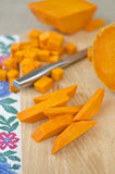 Preparing raw pumpkin for cooking Stock Photography