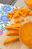 Preparing raw pumpkin for cooking Stock Images