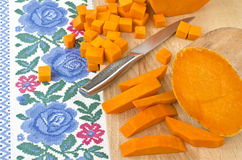 Preparing raw pumpkin for cooking Royalty Free Stock Image