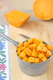 Preparing raw pumpkin for cooking Royalty Free Stock Photography