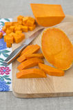 Preparing raw pumpkin for cooking Royalty Free Stock Images