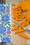 Preparing raw pumpkin for cooking Royalty Free Stock Photo