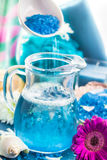 Preparing relaxing spa bath aromatic pouring salt Stock Images