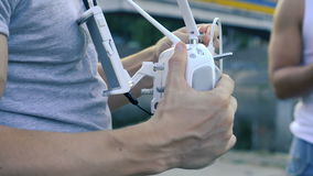 Preparing the remote control to fly drone quadrocopter stock video footage