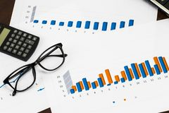 Preparing report. Blue graphs and charts. Business reports and p Stock Photography