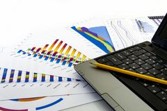 Preparing report. Blue graphs and charts. Business reports and pile of documents on gray reflection background stock photos