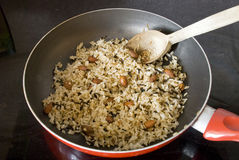 Preparing rice. Preparing brown rice with almond Stock Image