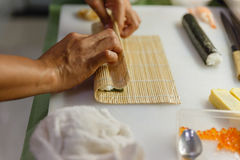 Preparing Rice and Seaweed before Rolling Sushi Roll by Using Bamboo Mat Stock Image