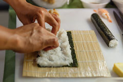 Preparing Rice and Seaweed before Rolling Sushi Roll by Using Bamboo Mat Royalty Free Stock Images