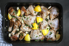 Preparing Roast Chicken with Lemon Garlic and Thyme Royalty Free Stock Photos