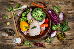 Preparing roast chicken with vegetables and spices,  view from a Royalty Free Stock Images