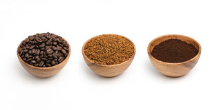 Preparing roasted coffee beans, granulated coffee and coffee powder in wooden bowl. Royalty Free Stock Photos