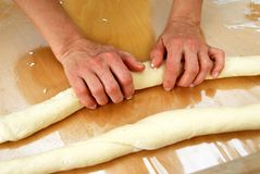 Preparing rolled pastry Royalty Free Stock Images