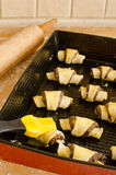Preparing Rugelach. Preparing poppy seed filled Rugelach - Jewish pastry Stock Photo