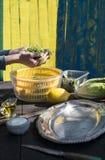 Preparing salad of arugula. Natural light royalty free stock photography