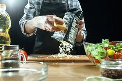 Preparing salad. Female chef cutting fresh vegetables. Cooking process. Selective focus royalty free stock photos