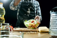 Preparing salad. Female chef cutting fresh vegetables. Cooking process. Selective focus stock photo