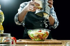 Preparing salad. Female chef cutting fresh vegetables. Cooking process. Selective focus royalty free stock image