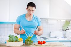 Preparing salad food lunch vegetables young man healthy eating c Royalty Free Stock Images