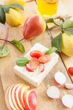 Preparing salad with fresh ingredients Stock Photography