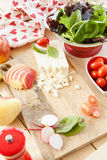 Preparing salad with fresh ingredients Royalty Free Stock Photography