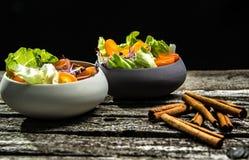 Preparing salad with radish sprouts, carott, green salad, tomato Royalty Free Stock Images