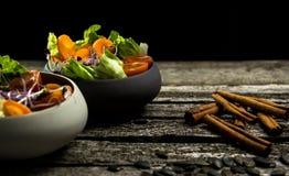 Preparing salad with radish sprouts, carott, green salad, tomato Royalty Free Stock Photography
