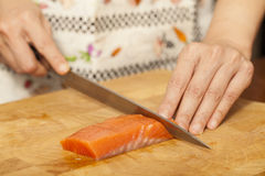 Preparing salmon Royalty Free Stock Images