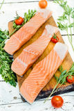 Preparing salmon fish. On wooden board,selective focus Royalty Free Stock Photo