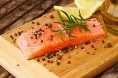 Preparing salmon steak Royalty Free Stock Image