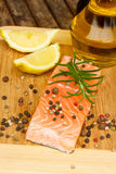 Preparing salmon steak Stock Photography