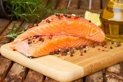 Preparing salmon steak with spicies Stock Photos