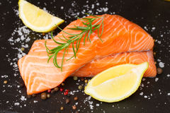 Preparing salmon steak Royalty Free Stock Image