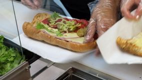 Preparing sandwich with ham and swiss cheese