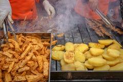 Preparing seasoned beef heart 'anticuchos' (Peruvian Gastronomy) Royalty Free Stock Photo