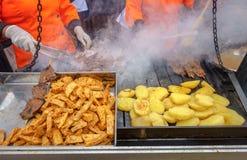 Preparing seasoned beef heart 'anticuchos' (Peruvian Style) Stock Images