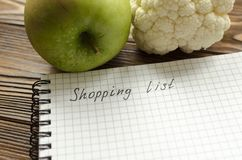 Preparing the shopping list before going to buy the groceries Stock Images
