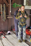 Preparing for skydiving in tandem Stock Images