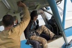 Preparing for skydiving in tandem Royalty Free Stock Image