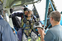 Preparing for skydiving in tandem Stock Images