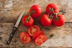 Preparing sliced ripe red tomatoes Stock Image
