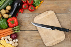 Preparing and slicing vegetables knife on cutting board Stock Image