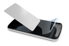 Preparing a smartphone with a protection film Royalty Free Stock Image