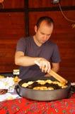Preparing smoked cheese Stock Photography