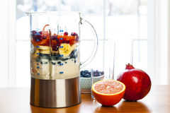 Preparing smoothies with fruit and yogurt royalty free stock image
