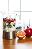 Preparing smoothies with fruit and yogurt Stock Photo