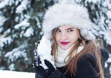 Preparing for a snowball fight. Girl preparing a snowball for a snowball fight Stock Photography