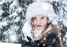 Preparing for a snowball fight. Girl preparing a snowball for a snowball fight Royalty Free Stock Photography