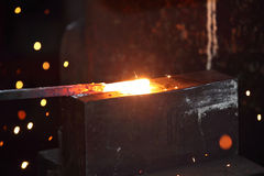 Preparing  some figure from hot steel stick. On the anvil with special tool Royalty Free Stock Photos